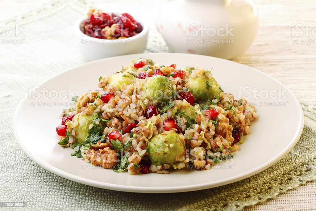 A plate full of warm buckweat salad with brussel sprouts royalty-free stock photo