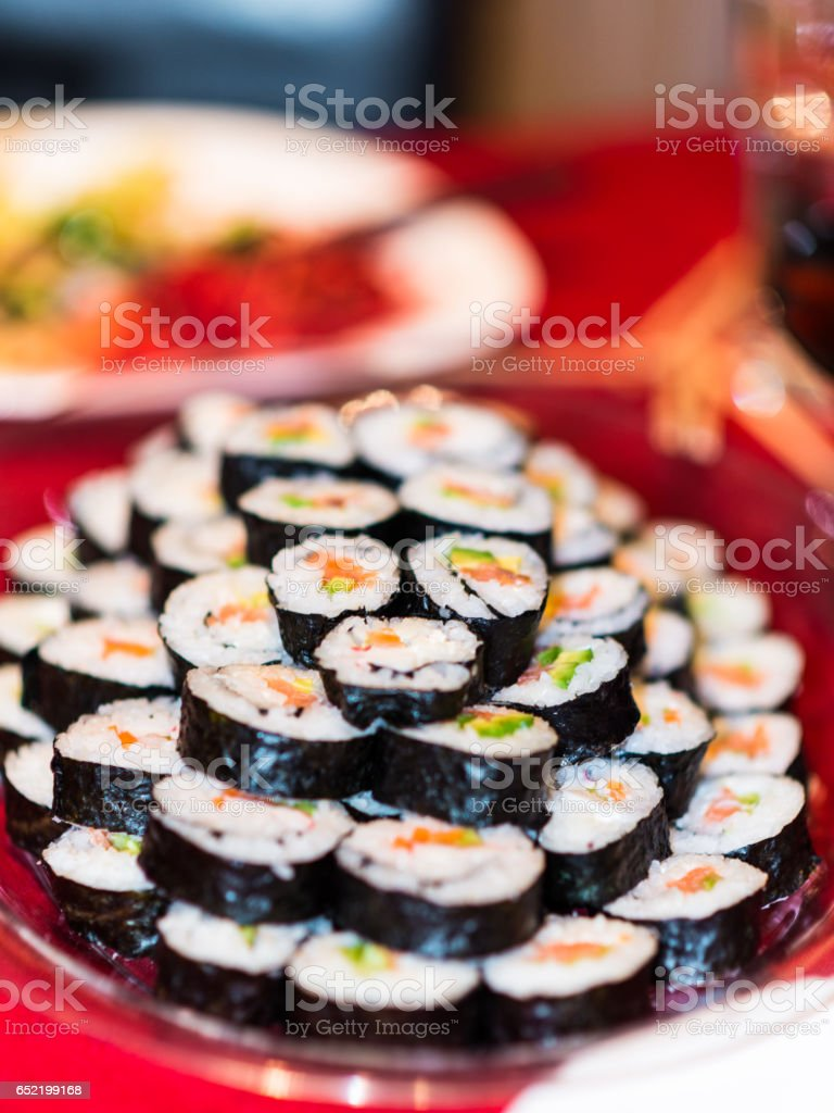 A plate full with sushi rolls. stock photo