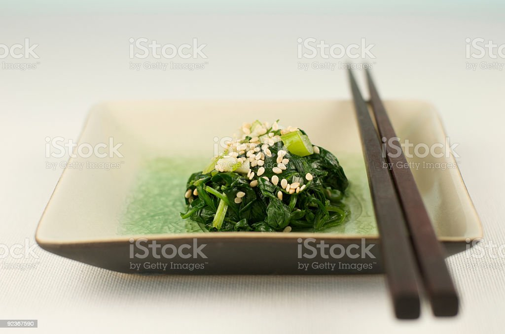 Plate of Asian Spinach with Chopsticks royalty-free stock photo