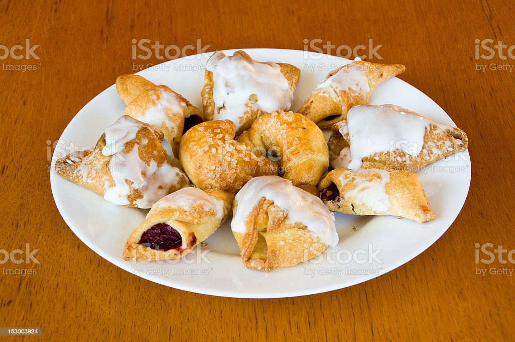 Plate of assorted pastry on wooden table stock photo