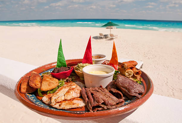 plate of authentic mexican food - playa del carmen stock photos and pictures