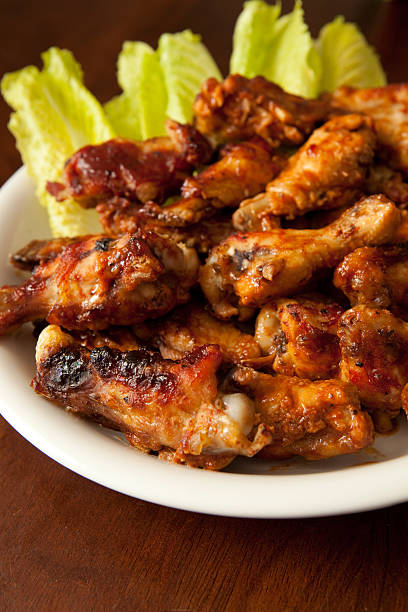 Plate of BBQ Chicken Wings - Shallow DOF stock photo