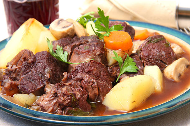 Plate of beef bourguignon for dinner Beef Bourguignon beef bourguignon stock pictures, royalty-free photos & images