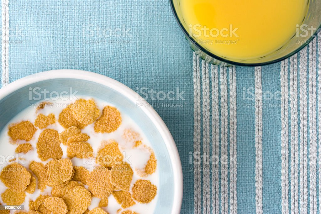 plate of breakfast cereal and orange juice on table-clotch royalty-free stock photo