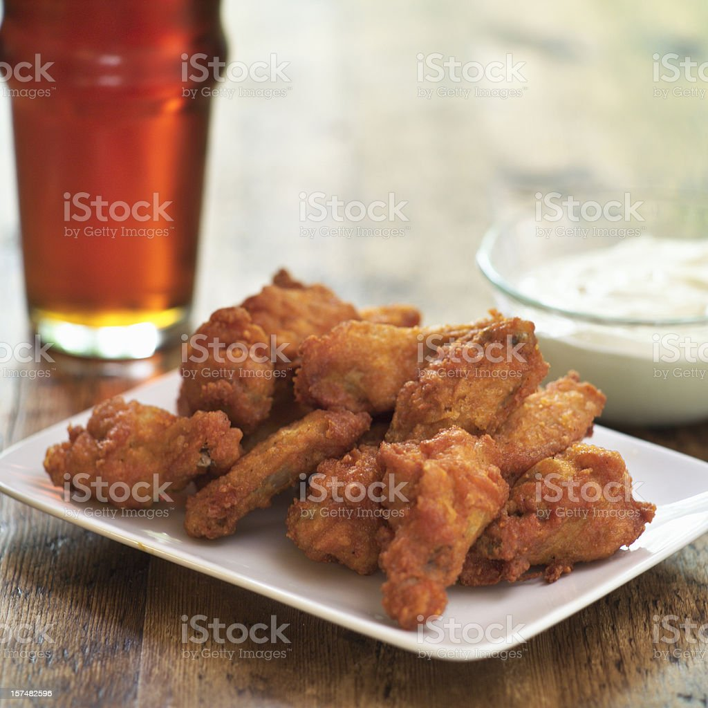 A plate of buffalo hot wings and a dip royalty-free stock photo