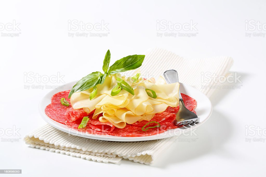 plate of cheese and salami royalty-free stock photo
