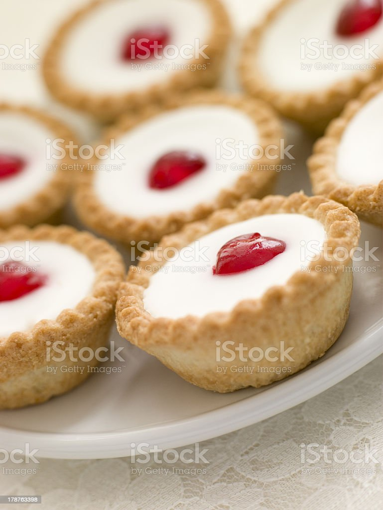 Plate of Cherry Bakewell Tarts stock photo