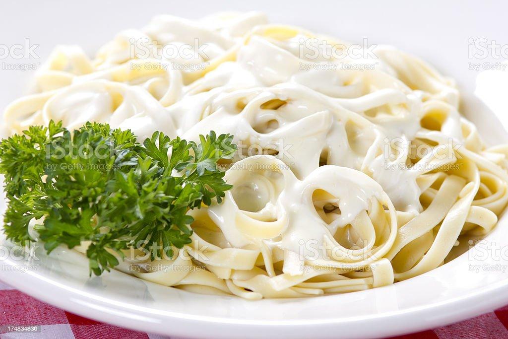 Plate of chicken fettuccine alfredo stock photo