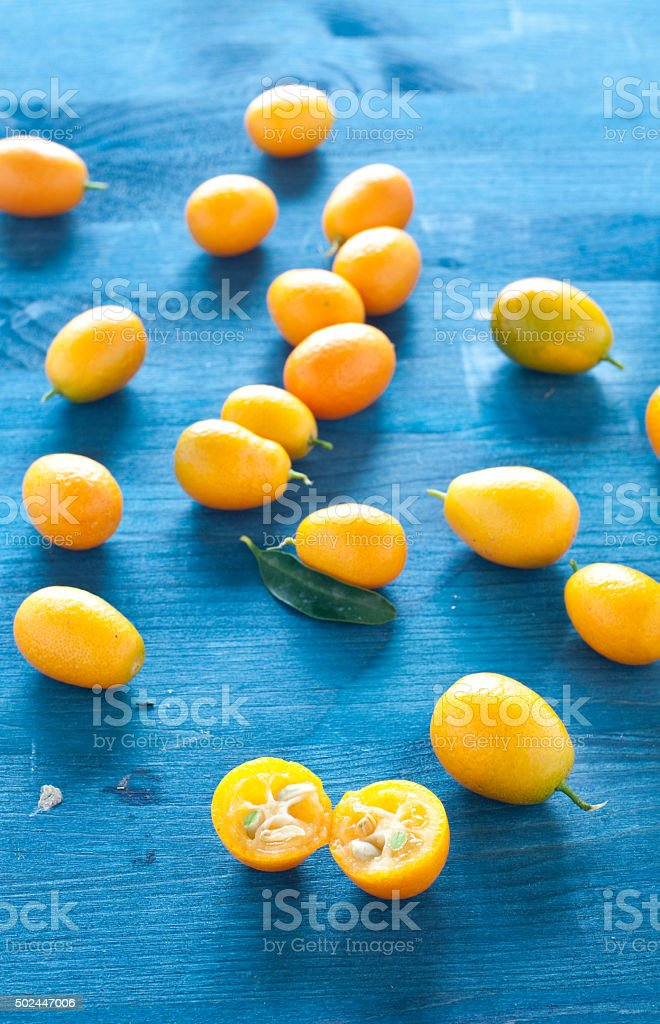 Plate of Chinese mandarins on wooden background stock photo