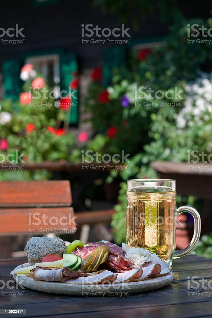 Plate of coldcuts with juice royalty-free stock photo