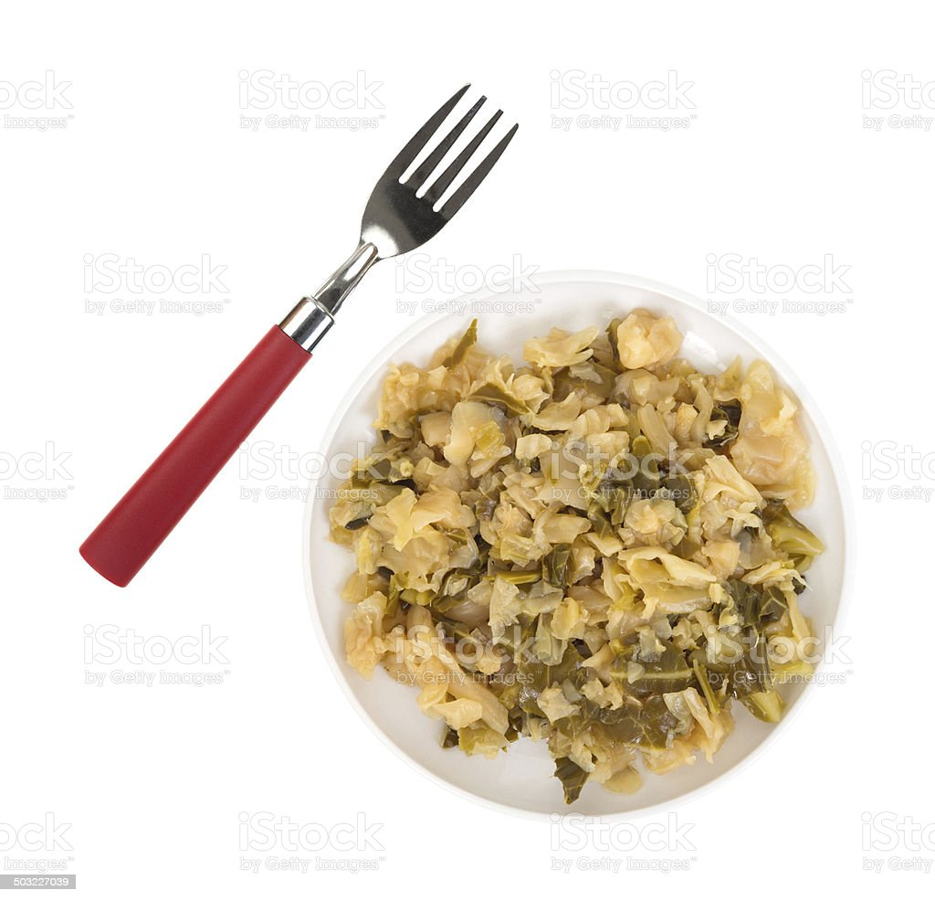 Plate of cooked cabbage with fork to the side royalty-free stock photo
