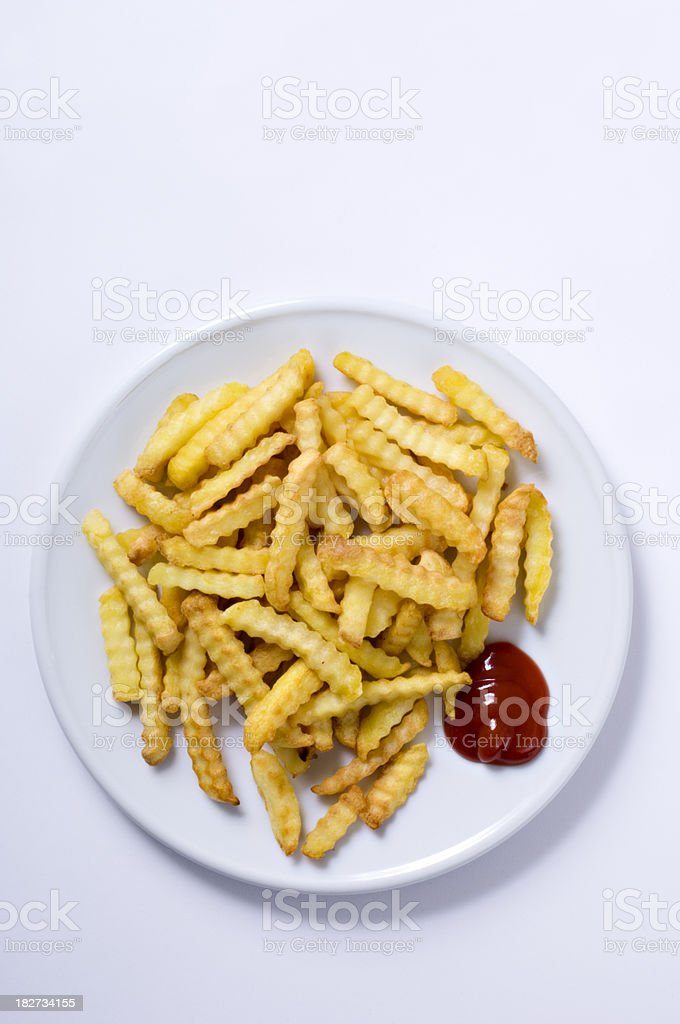 Plate Of Crinkle Cut Fries With Ketchup White Background stock photo