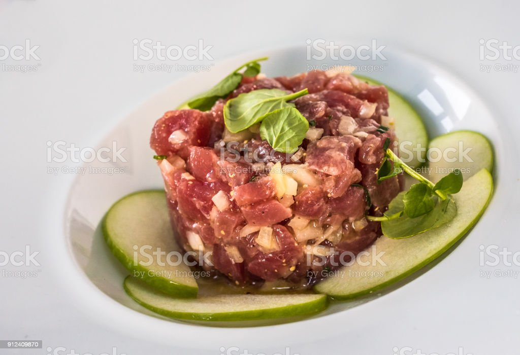 A plate of delicious tuna tartare with green apple stock photo