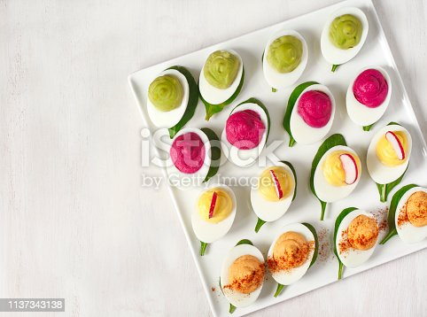 istock A plate of deviled eggs on dark grey stone background, top view 1137343138
