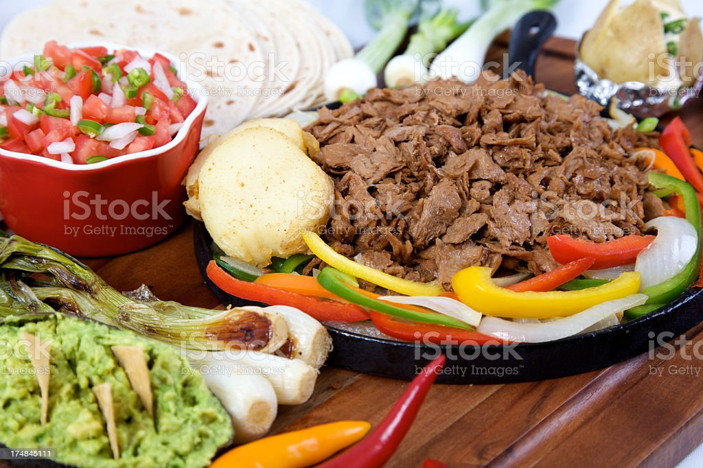 plate of fajitas and peppers royalty-free stock photo