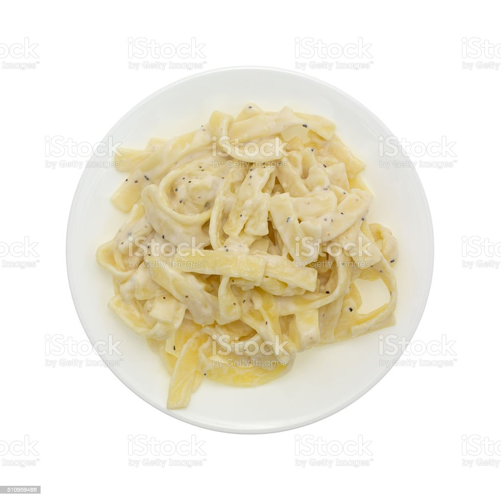 Plate of fettuccine alfredo on a white background stock photo