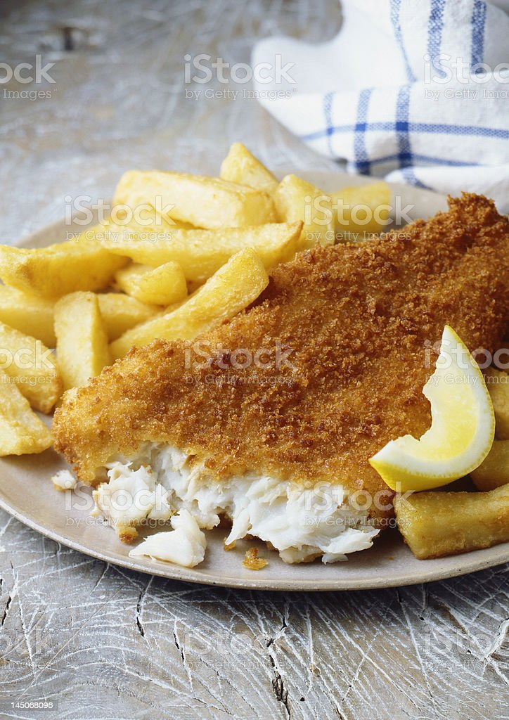 Plate of fish and chips with lemon stock photo