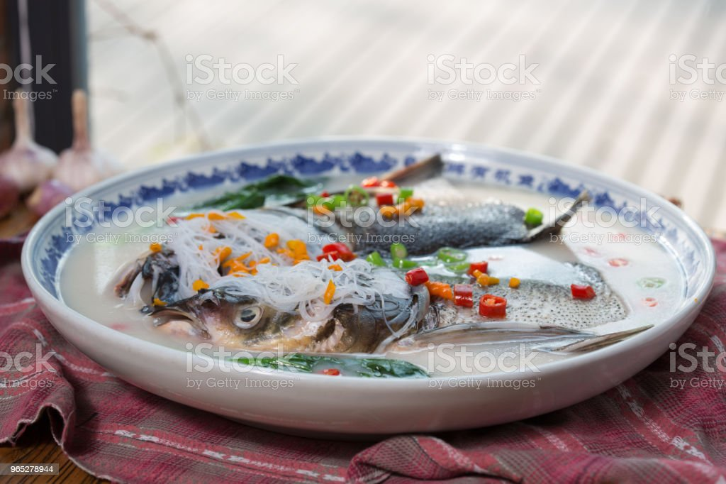 A plate of fish heads with chopped peppers royalty-free stock photo