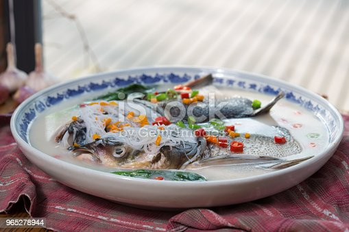 A Plate Of Fish Heads With Chopped Peppers Stock Photo & More Pictures of Animal Body Part