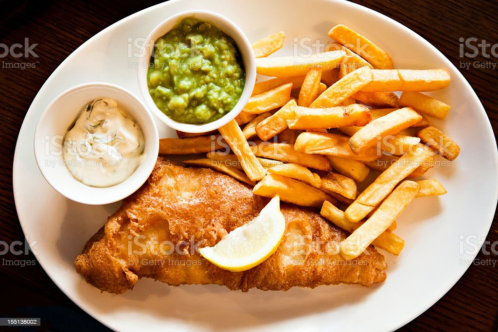 Plate of Fisn and Chips with tartar sauce mushy peas royalty-free stock photo