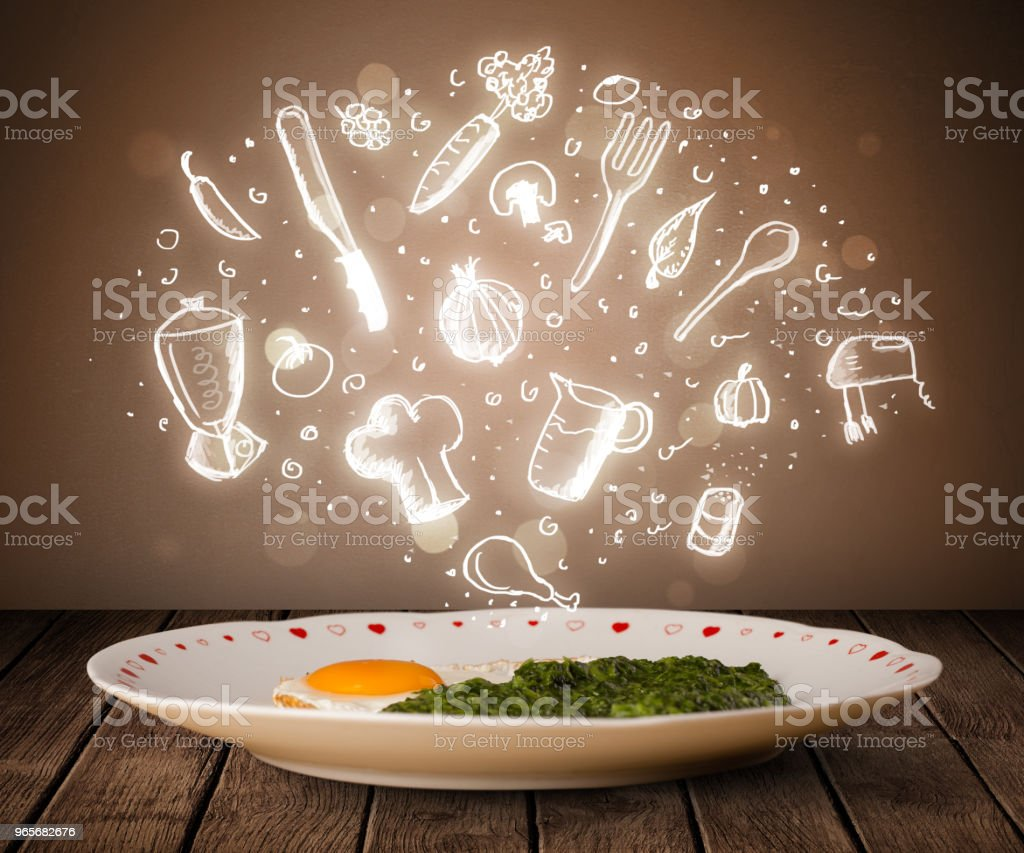 Plate of food with white kitchen icons stock photo