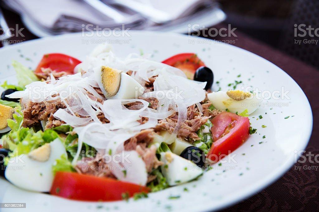 Plate of Fresh Nicoise Salad or Tuna Salad stock photo