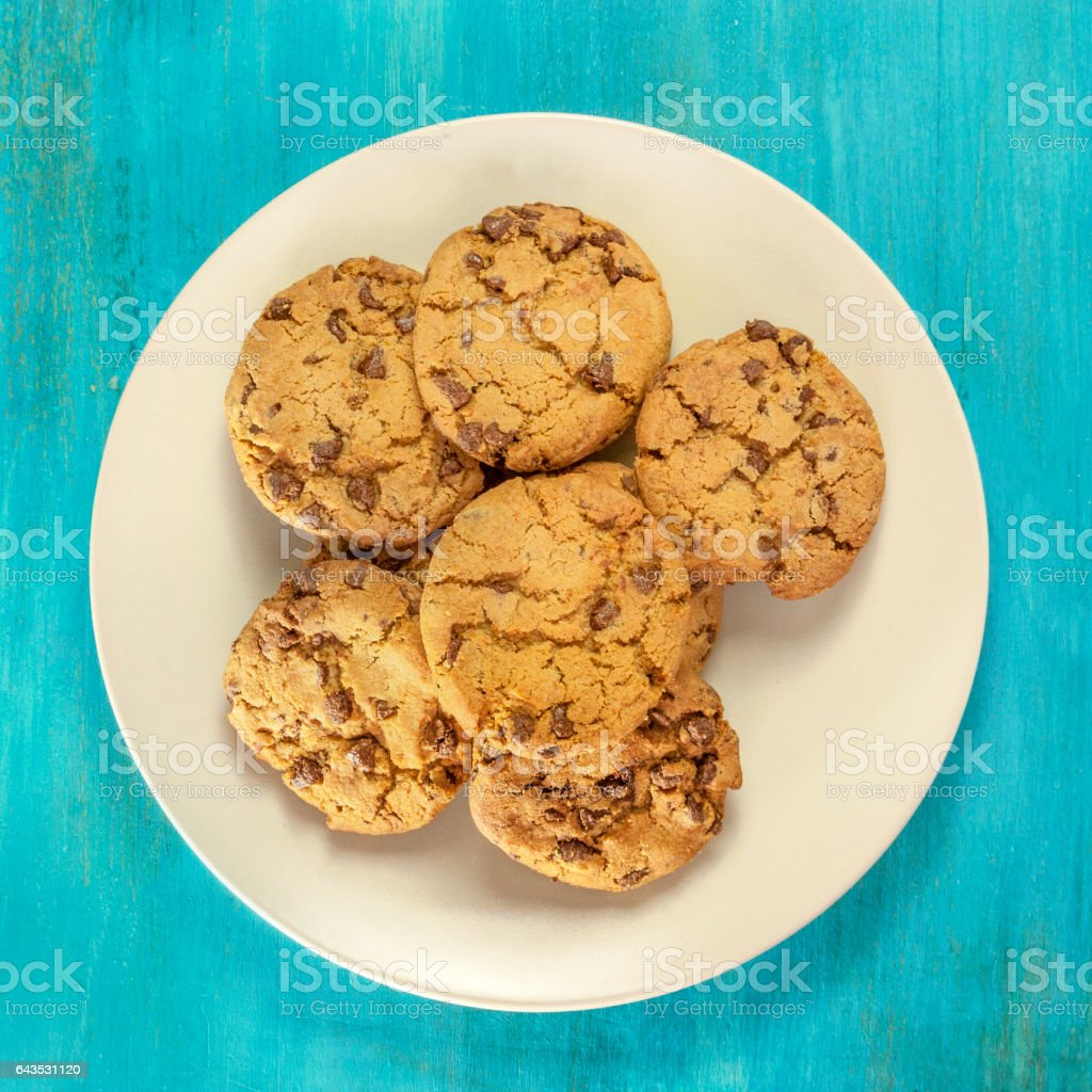 Plate of freshly baked chocolate chips cookies, with copyspace stock photo