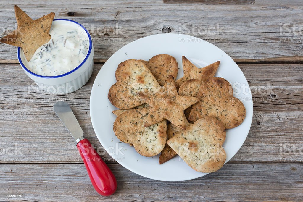 plate of freshly baked tortilla chips with spinach dip. stock photo