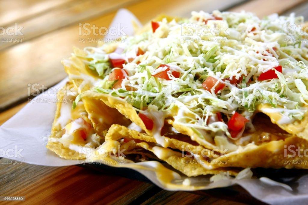 Plate of freshly made nachos stock photo