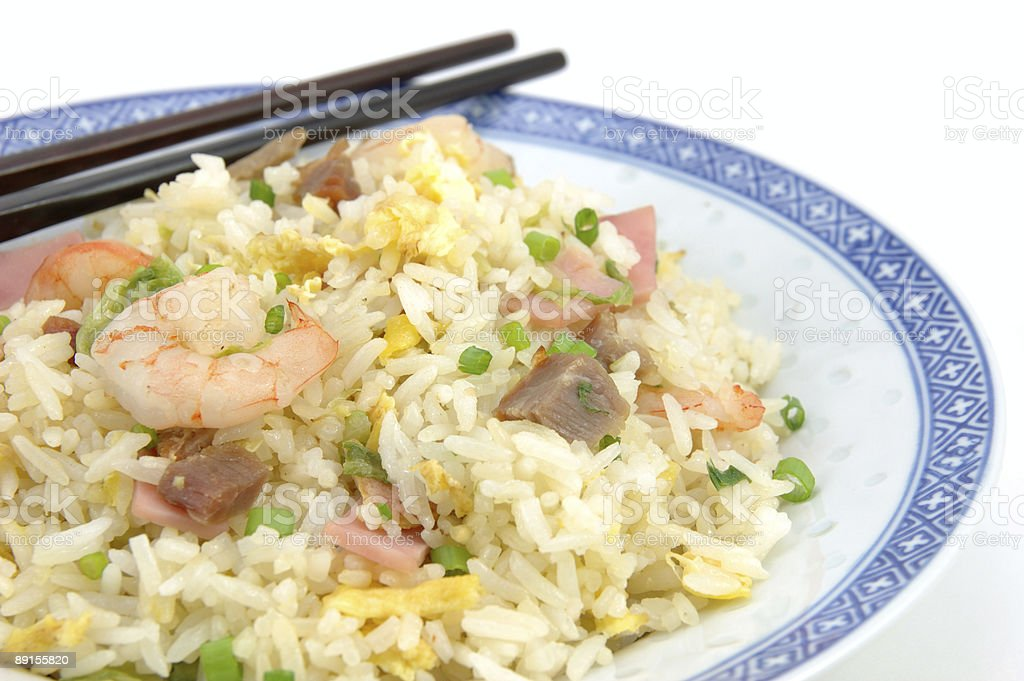 Plate of fried rice and chopsticks royalty-free stock photo