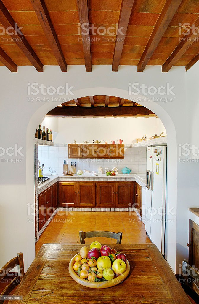 Plate of fruit and wooden kitchen in a country house stock photo