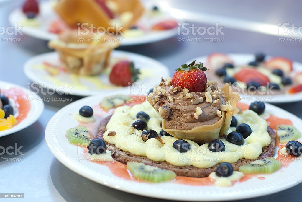 Plate of fruits and Chocolate moose with tulip wafer. royalty-free stock photo