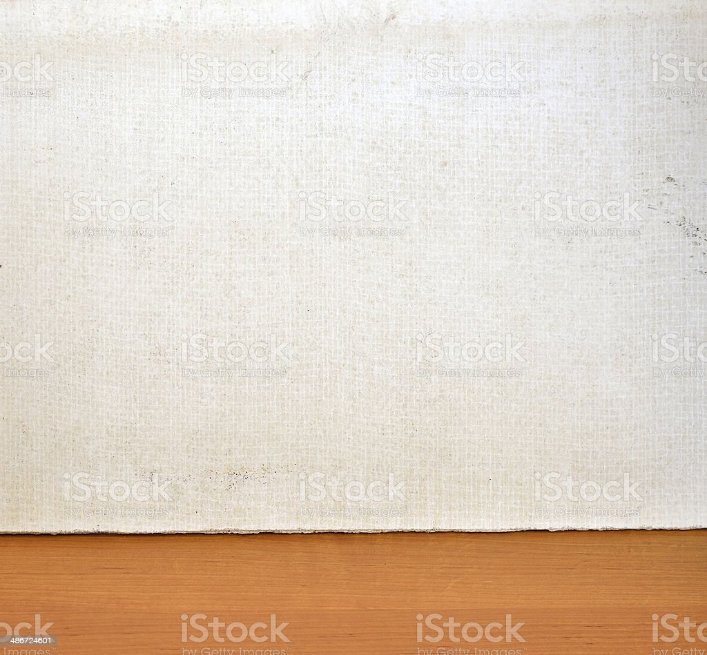 Plate of glass fibers and gypsum on wooden surface stock photo