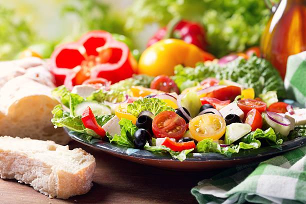 plate of greek salad stock photo