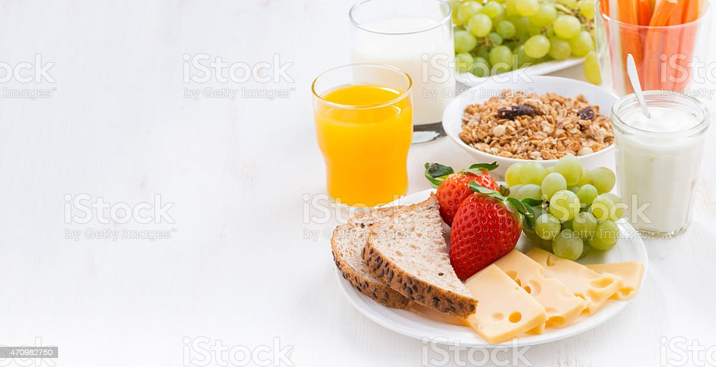 A plate of healthy food with milk and orange juice stock photo