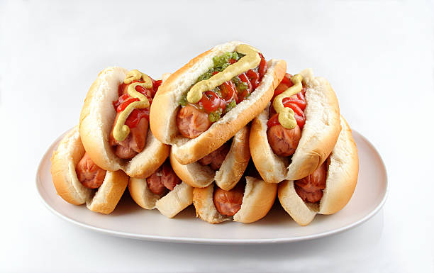 plate of hotdogs - hot dog stock pictures, royalty-free photos & images