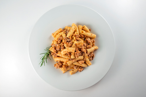 Plate Of Macaroni Pasta With Bolognese Ragù Stock Photo - Download Image Now