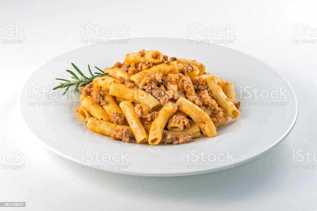 Plate of macaroni pasta with Bolognese ragù royalty-free stock photo