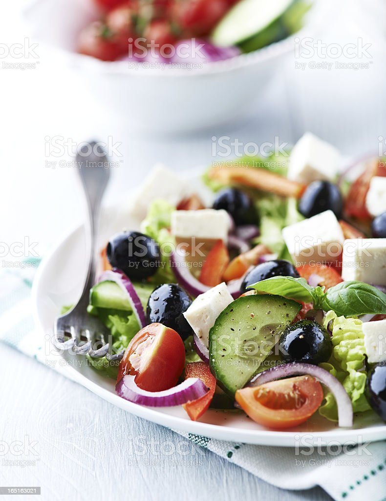 Plate of Mediterranean salad with feta cheese and olives stock photo