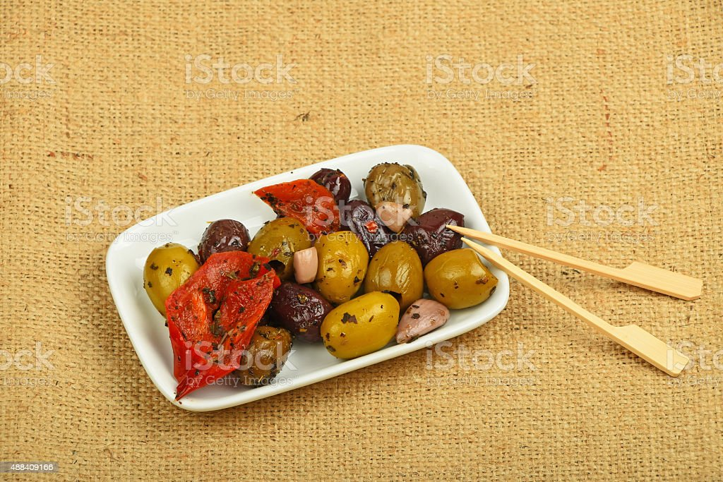 Plate of Mediterranean snack of olives mix on canvas royalty free stockfoto