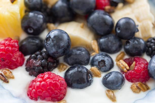 Plate of mixed fruits with yogurt stock photo