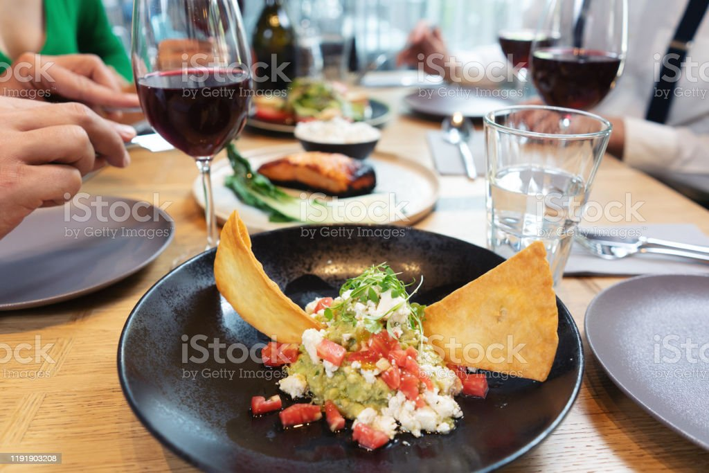 Plate Of Nice Food In A Fancy Restaurant On Table With People Eating Stock Photo Download Image Now Istock