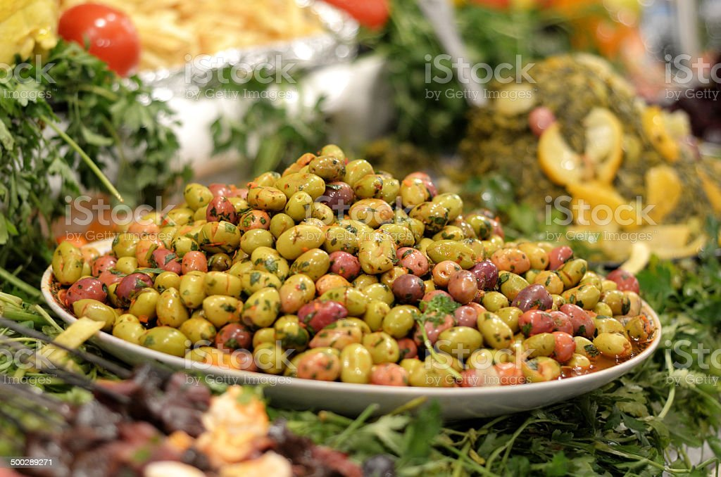 Plate of olives with herbs royalty-free stock photo