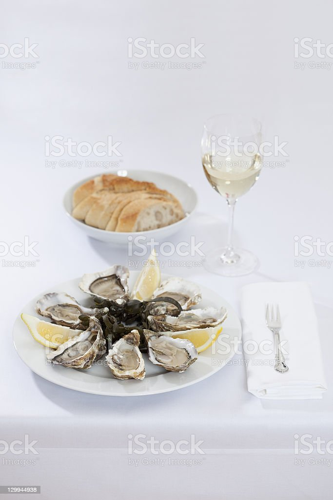Plate of oysters and bread stock photo