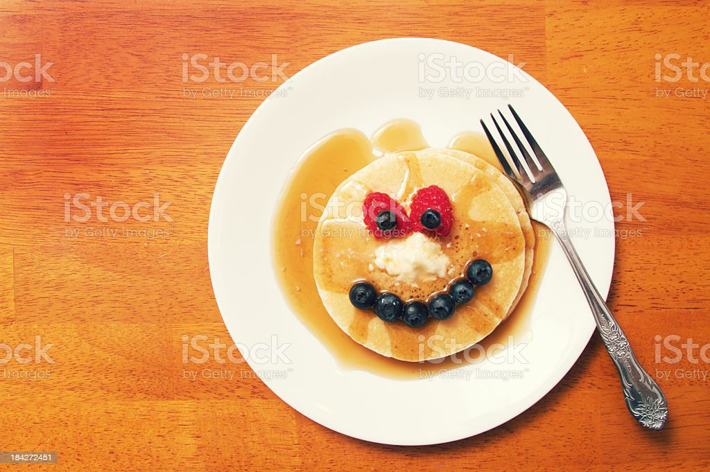 Plate of Pancakes with a Funny Face stock photo