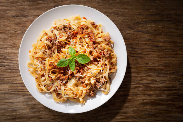 plate of pasta bolognese, top view stock photo