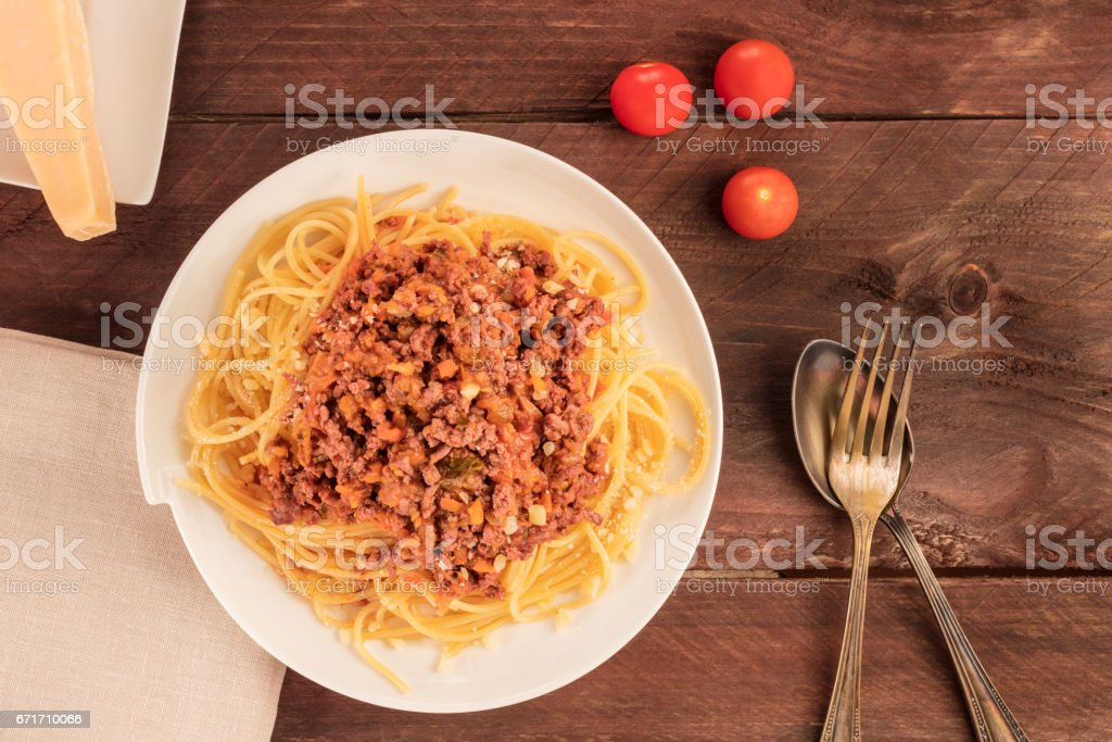 Plate of pasta with meat, tomato sauce, and cheese stock photo