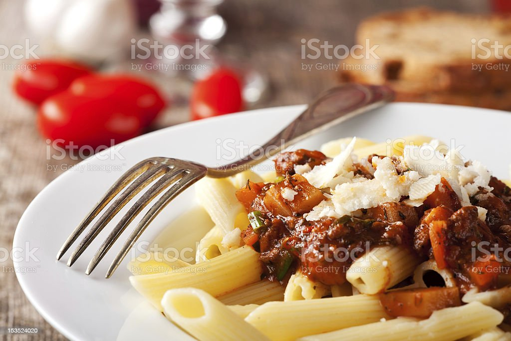 A plate of penne with ground meat and cheese stock photo