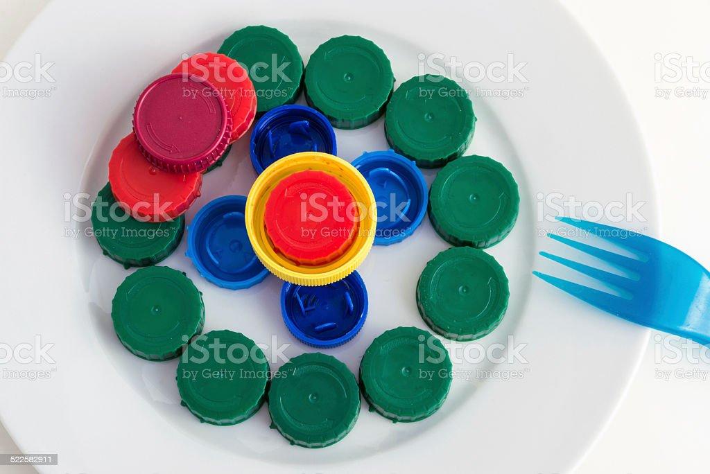 plate of plastic caps stock photo