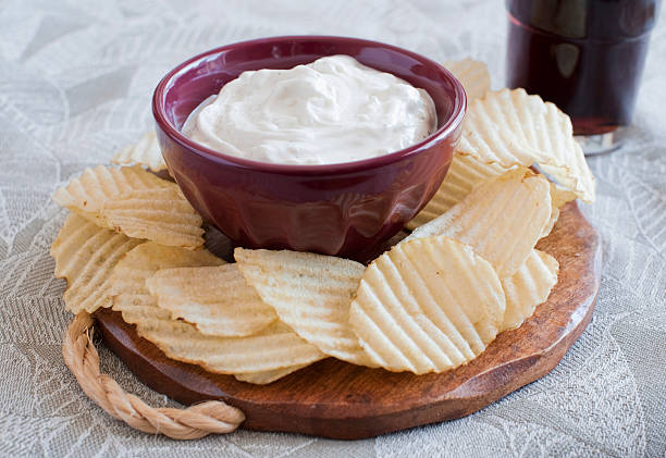 Plate of potato chips and dip with a soda stock photo